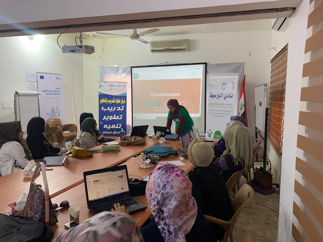Nadia at the front of the classroom, training a group of female volunteers.