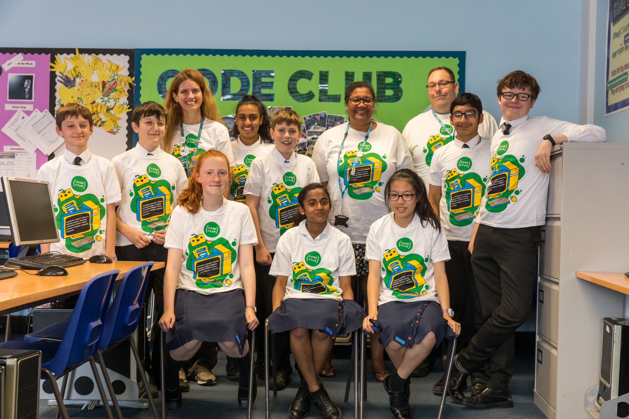 Children from Cheam Code Club wearing the winning T-shirt design.